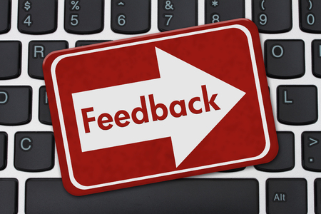 A red sign with text Feedback on a computer keyboard Stock Photo