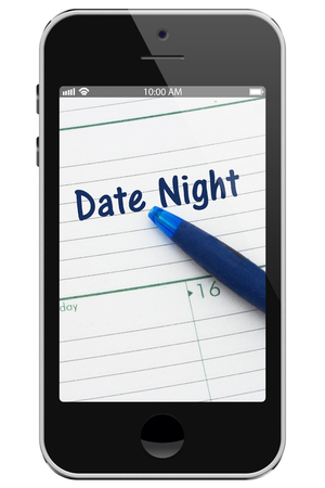 dattes: Planning your Date Night, A cell phone display with pen and a day planer with text Date Night
