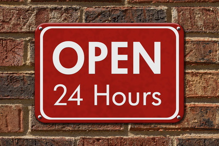 Open 24 Hours Sign, A red hanging sign with text Open 24 Hours on a brick wall Banco de Imagens