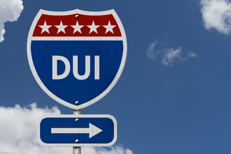 dui: American DUI Highway Road Sign, Red, White and Blue American Highway Sign with words DUI with sky background