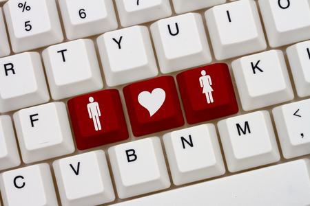 internet dating: Internet Dating Sites, A close-up of a keyboard with red highlighted symbol of man and women and heart