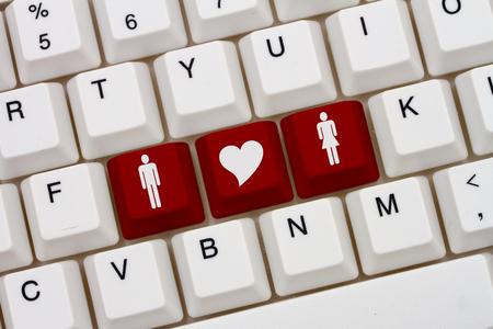 simbolo de la mujer: Sitios de citas en Internet, un primer plano de un teclado con rojo destacaron símbolo del hombre y la mujer y el corazón
