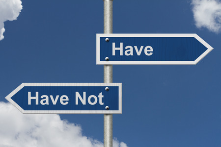 Have versus Have Not, Two Blue Road Sign with text Have and Have Not with sky background Stock Photo