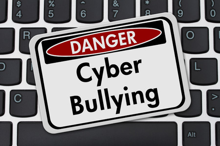 overwhite: Cyber Bullying Danger Sign, A white danger sign with text Cyber Bullying on a keyboard