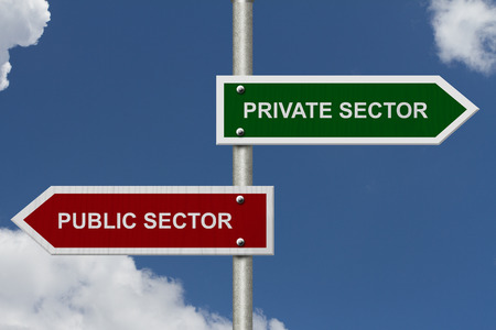 public private: Private Sector versus Public Sector concept, Red and Green street signs with blue sky with words Private Sector versus Public Sector