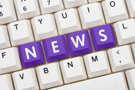 news current events: Getting your news on the internet, A close-up of a keyboard with purple highlighted text News