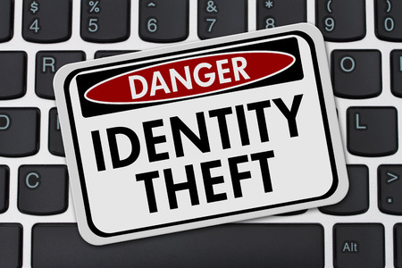 identity theft: Identity Theft Danger Sign, A danger sign with text Identity Theft on a keyboard Stock Photo