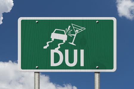 under the influence: Driving Under the Influence Road Sign,  A green Road Sign with a car crashing into a martini glass with sky background