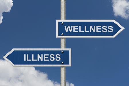 illness: Being Well versus having an Illness, Two Blue Road Sign with text Illness and Wellness with sky background