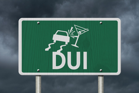 under the influence: Driving Under the Influence Road Sign,  A green Road Sign with a car crashing into a martini glass with stormy sky background Stock Photo