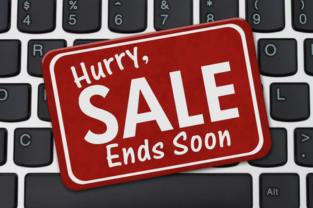 the ends: Hurry Sale Ends Soon Sign, A red sign with text Hurry Sale Ends Soon on a keyboard