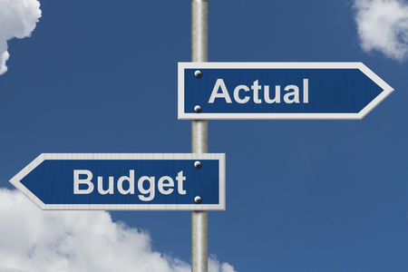 actual: Actual versus what was budgeted, Two Blue Road Sign with text Actual and Budget with sky background Stock Photo