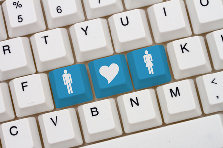 simbolo de la mujer: Internet Dating Sites, A close-up of a keyboard with blue highlighted symbol of man and women and heart