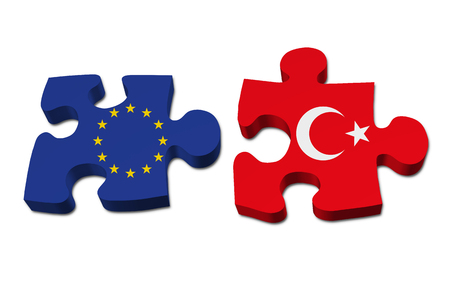 overwhite: Relationship between the European Union and Turkey, Two pieces of a puzzle with the European Union flag on one and the Turkey flag on the other isolated over white Stock Photo