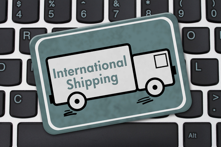 computers online: International Shipping Sign, A teal hanging sign with text International Shipping on a truck on a keyboard