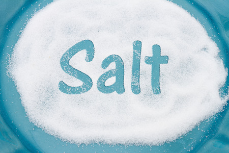 Close-up of Teal Plate with a lot of salt with text Salt