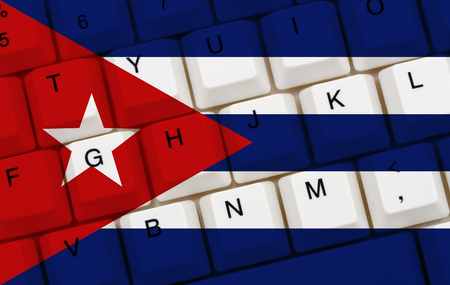 computers online: Restricted Internet access in Cuba, The Cuban flag on a  computer keyboard