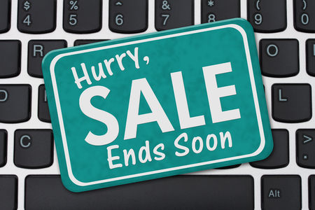computers online: Hurry Sale Ends Soon Sign, A teal sign with text Hurry Sale Ends Soon on a keyboard Stock Photo