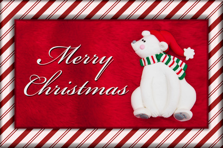 candy border: Merry Christmas Greeting, Red Plush Fur, Christmas Bear Christmas and Candy Cane Border with text Merry Christmas Stock Photo