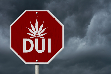 dui: Stop Driving Under the Influence Road Sign, Red and White Stop Sign with words DUI and marijuana leaf with stormy sky background