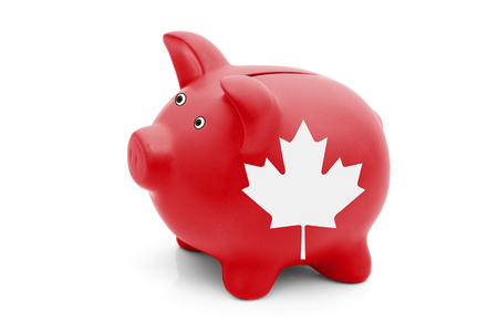 invest: Saving and Investing in Canada, A red piggy bank with a white Canadian maple leaf flag isolated on white