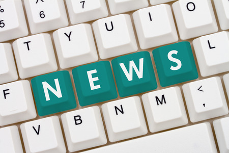 news current events: Getting your news on the internet, A close-up of a keyboard with teal highlighted text News