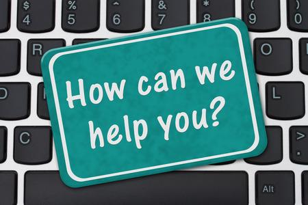 Comment pouvons-nous vous aider à identifier, Un signe sarcelle d'hiver avec le texte Comment pouvons-nous vous aider sur un clavier