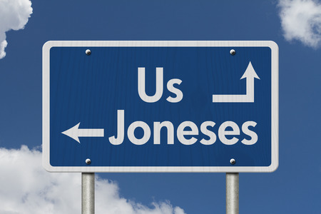 keeping: Keeping up with the Joneses, Blue Road Sign with text Us and Joneses with sky background