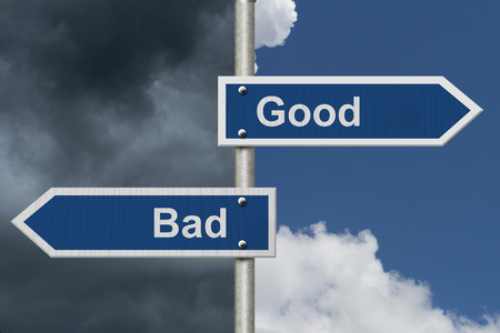 good: Good Versus Bad , Two Blue Road Sign with text Good and Bad with bright and stormy sky background Stock Photo