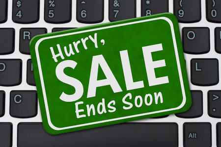 the ends: Hurry Sale Ends Soon Sign, A green sign with text Hurry Sale Ends Soon on a keyboard