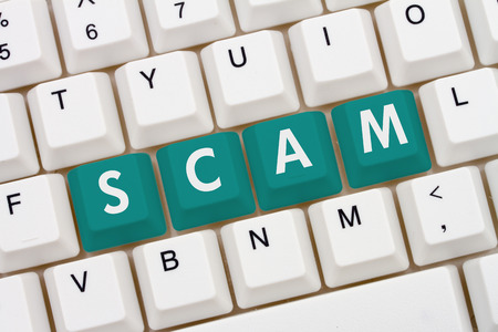 web scam: Internet Scams, A close-up of a keyboard with teal highlighted text Scam