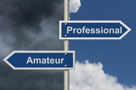 amateur: Difference between being a professional or an amateur , Two Blue Road Sign with text Professional and Amateur with bright and stormy sky background Foto de archivo