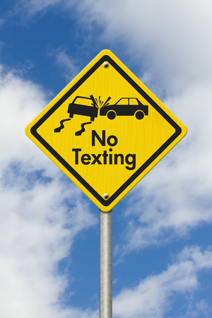 No Texting Yellow Warning Highway Road Sign, Yellow Warning Highway Sign with words No Texting and car crash with sky background