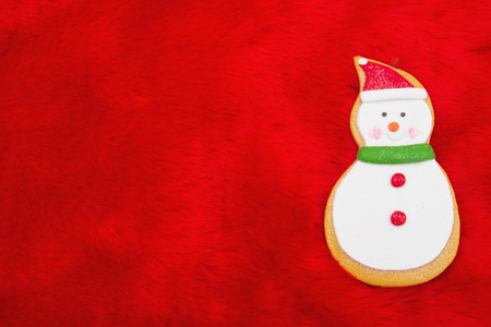 blank spaces: Red Plush Fur and Gingerbread Snowman Christmas Background with copy space for your message