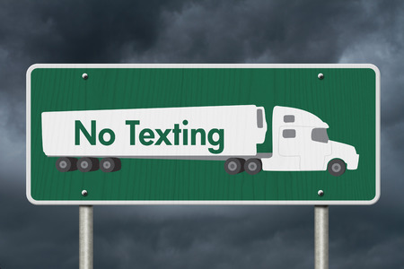 txt: No Texting Road Sign,  A green Road Sign with text No Texting and a truck with stormy sky background Stock Photo