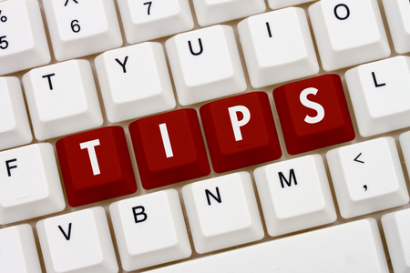computers online: Getting Tips online, A close-up of a keyboard with red highlighted text Tips Stock Photo