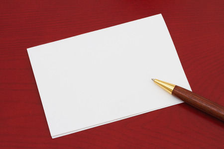 Blank Greeting Card, White Greeting card that is blank for your message on a red wood background Stock fotó