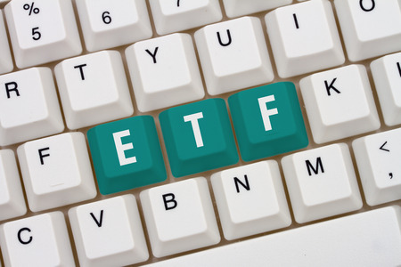 traded: Exchange Traded Funds online, A close-up of a keyboard with teal highlighted text ETF
