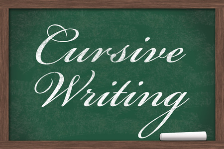 cursive: Chalkboard with text of Cursive Writing with a piece of chalk with copy-space