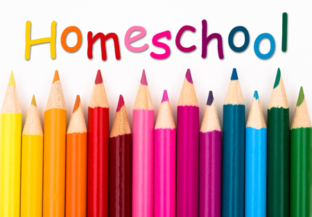 over white: Pencil Crayons with text Homeschool isolated over white