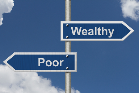 versus: Being Wealthy versus Being Poor, Two Blue Road Sign with text Wealthy and Poor with sky background