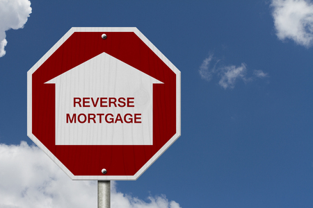 reverse: Stop Reverse Mortgage Borrowing Road Sign, Red and White Stop Sign with words Reverse Mortgage with sky background