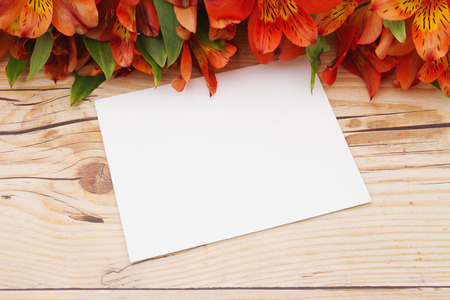 space wood: Some lilies on weathered wood with a blank Greeting Card and copy space for your message