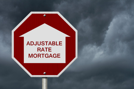 white interest rate: Stop getting a adjustable rate mortgages Road Sign, Red and White Stop Sign with words adjustable rate mortgage with home symbol with stormy sky background