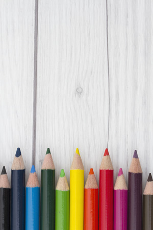 copyspace: Pencil Crayons with weathered wood and copy-space for your text Stock Photo