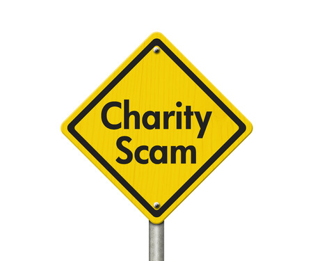 overwhite: Charity Scam yellow warning highway road sign, Yellow warning highway sign with words Scam Alert isolated over white Stock Photo