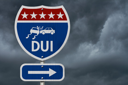 under the influence: American DUI Highway Road Sign, Red, White and Blue American Highway Sign with words DUI with stormy sky background Stock Photo