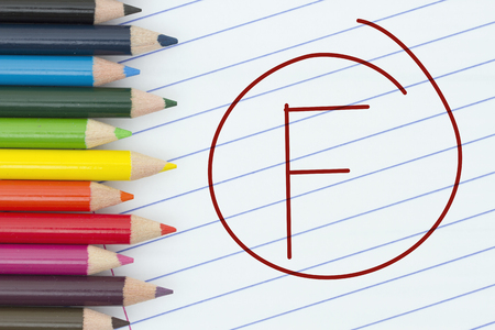 loose leaf: Being a F grade student, Pencil Crayons with loose leaf paper and a grade F