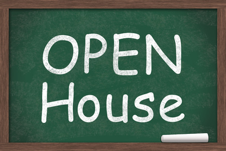 Chalkboard with text of Open House with a piece of chalk with copy-space