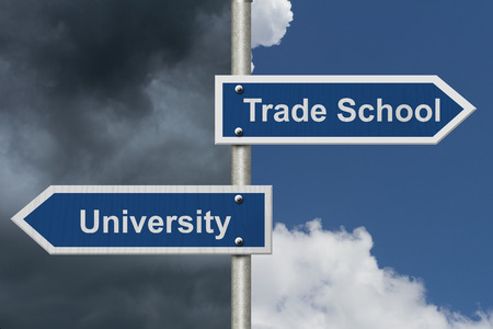 whether: Deciding on whether to go to University or Trade School, Two Blue Road Sign with text University and Trade School with bright and stormy sky background Stock Photo
